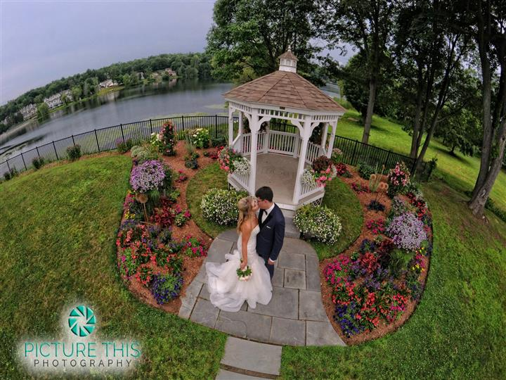 couple kissing near the outdoor gazebo during the day