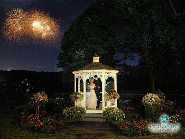 couple kissing in the outdoor gazebo at night time