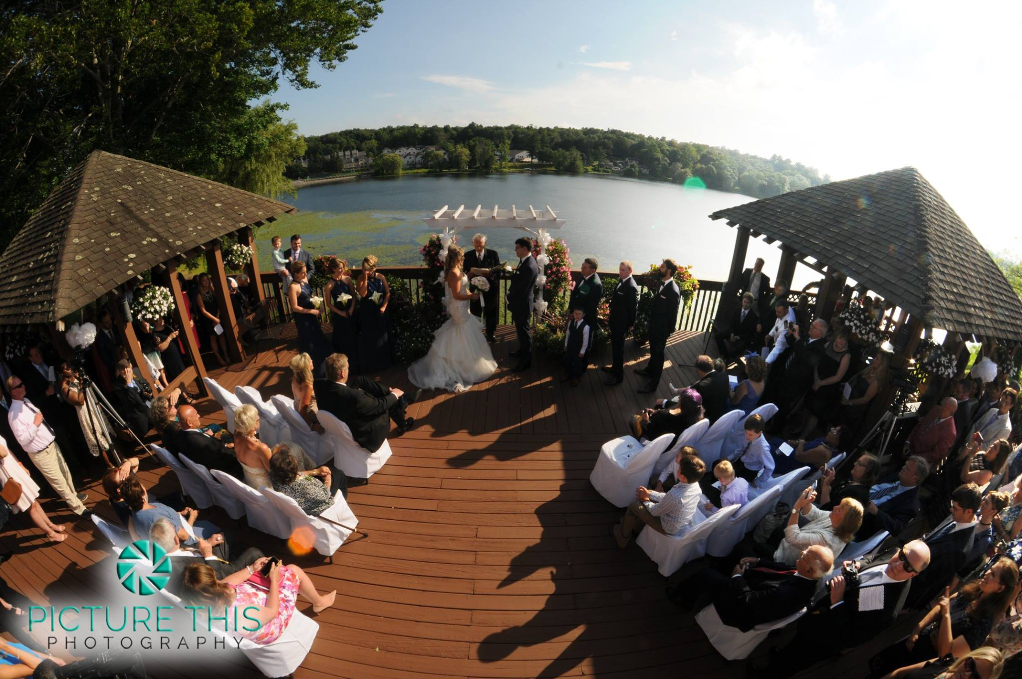 outdoor lakeside wedding ceremony on the deck
