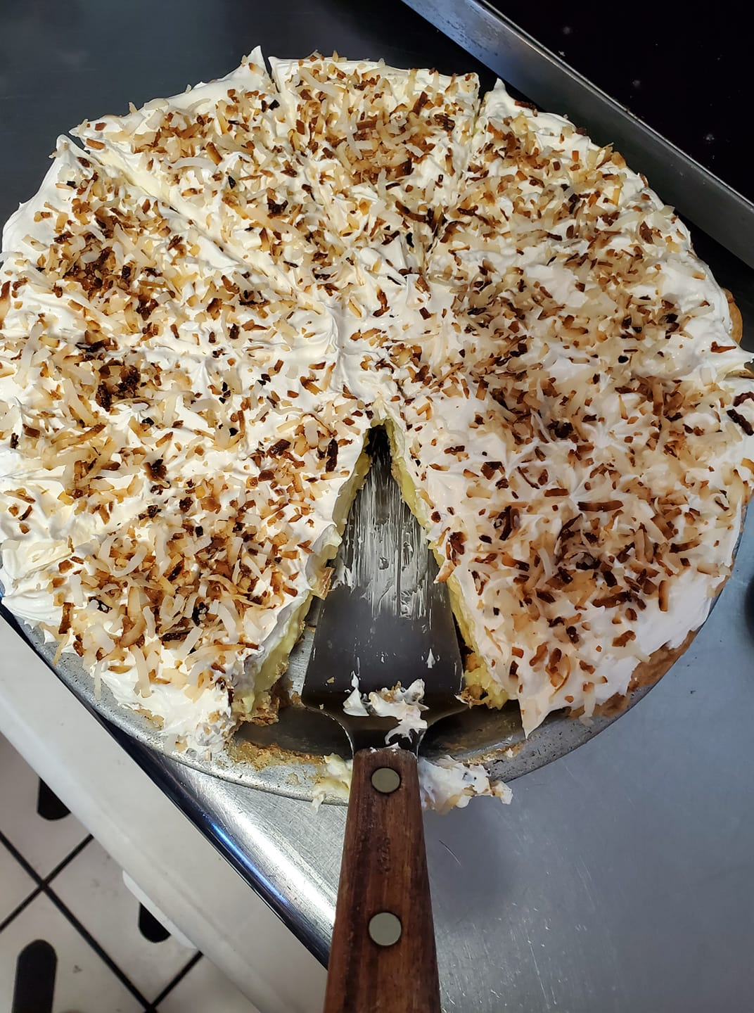 Coconut cake with serving spoon