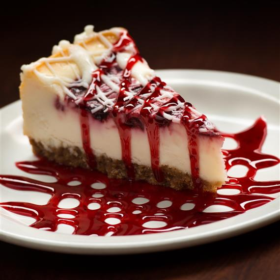 A raspberry drizzled cheesecake