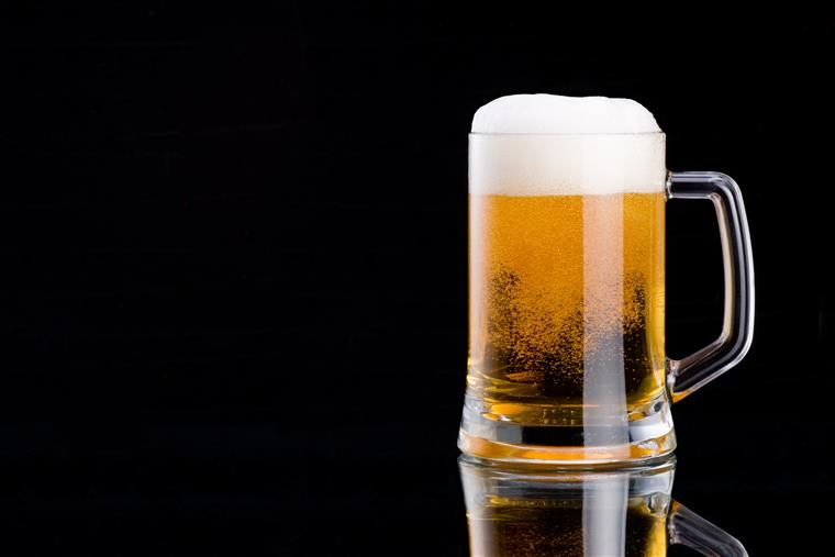 A glass mug filled with beer