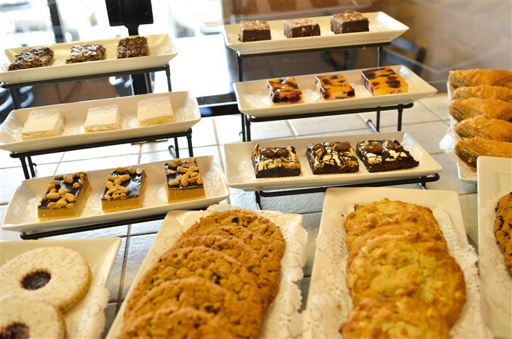 bakery counter with various baked goods and pastries on display