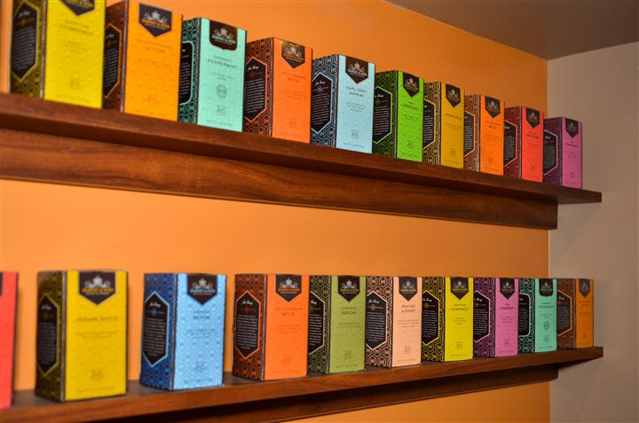 shelves stocked with various types of tea