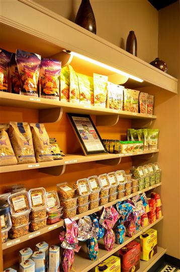 shelves inside the business stocked with different goods