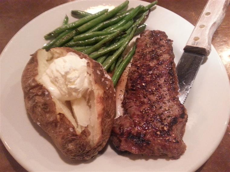 Strip steak with baked potato