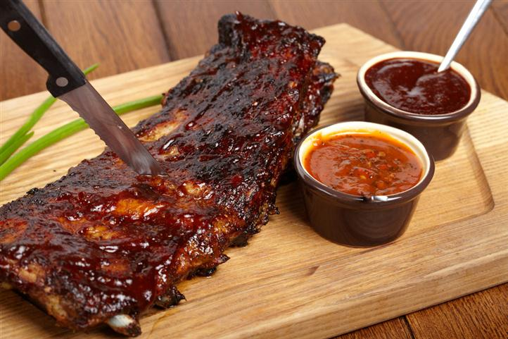 Barbecued Ribs with Barbecue sauce and seasoning sauce to the side