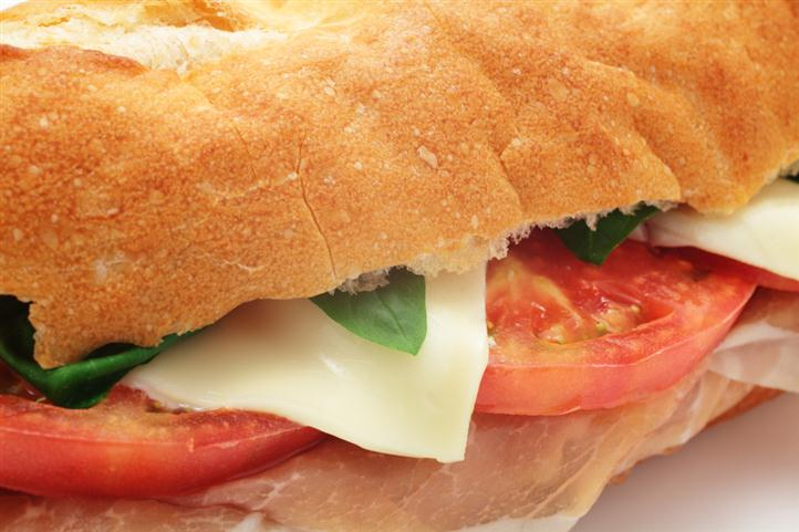 Sub Sandwich with tomatoes, cheese, and lettuce