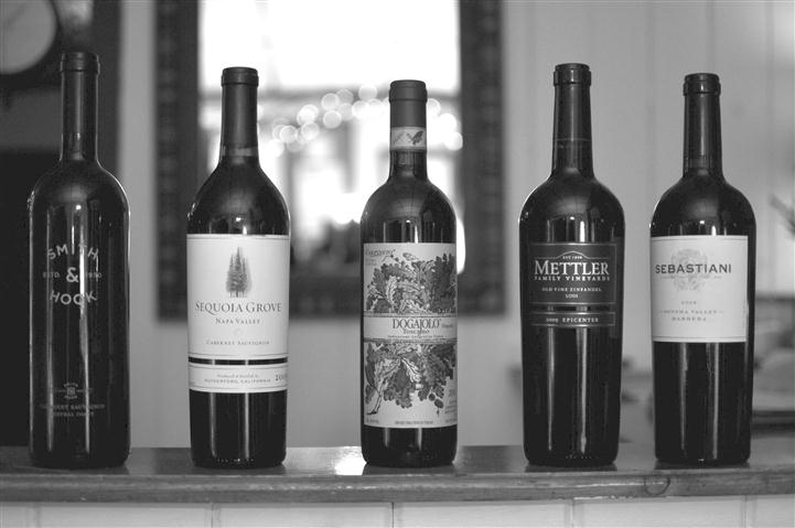 Black and white image of 5 bottles of wine.