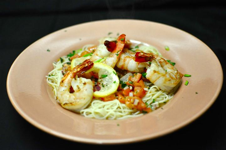 Shrimp & Lobster Alfredo with a creamy garlic Parmesan sauce tossed with fresh fettuccine pasta.