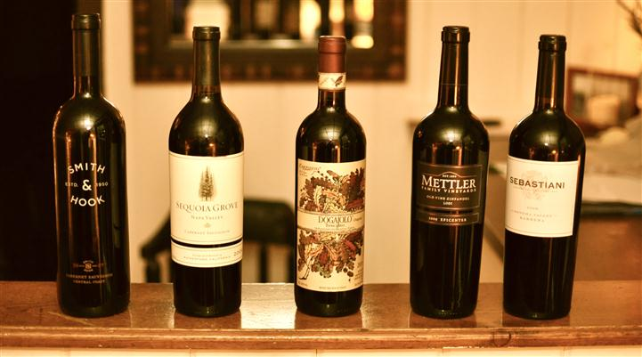 Three bottles of red wine.