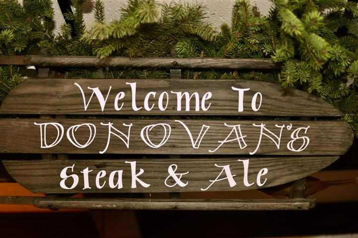 Welcome to Donovan's Steak & Ale sign outside.