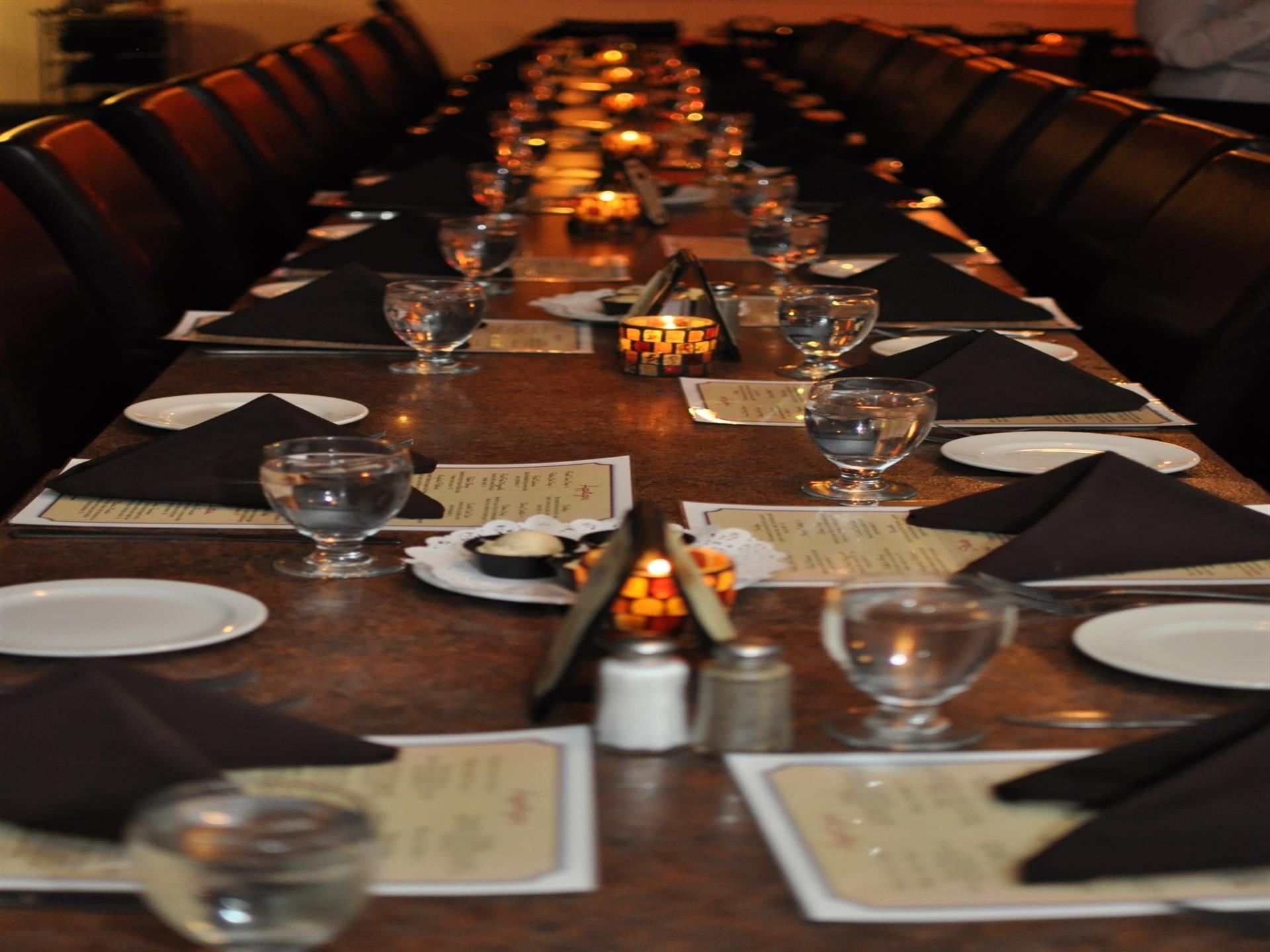 long table with plates and silverware