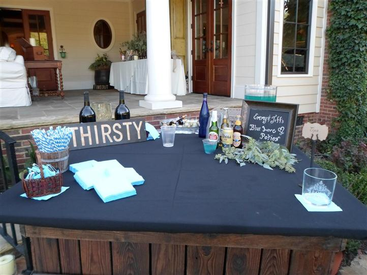 table with various drinks and a sign that reads thirsty