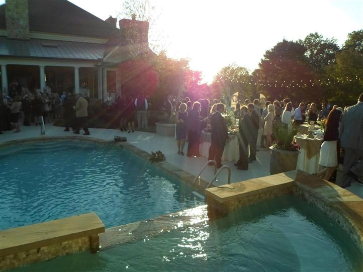 guests standing around a pool