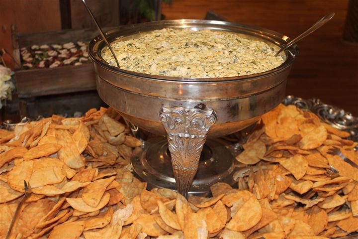big bowl of dip surrounded by chips