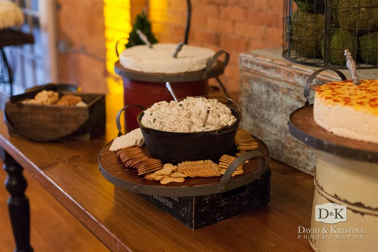 catering table with various dip and crackers