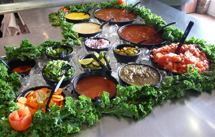 Mexican style food laid out buffet style