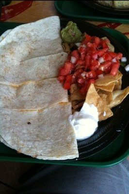Soft tortillas and tortilla chips served with salsa and cream