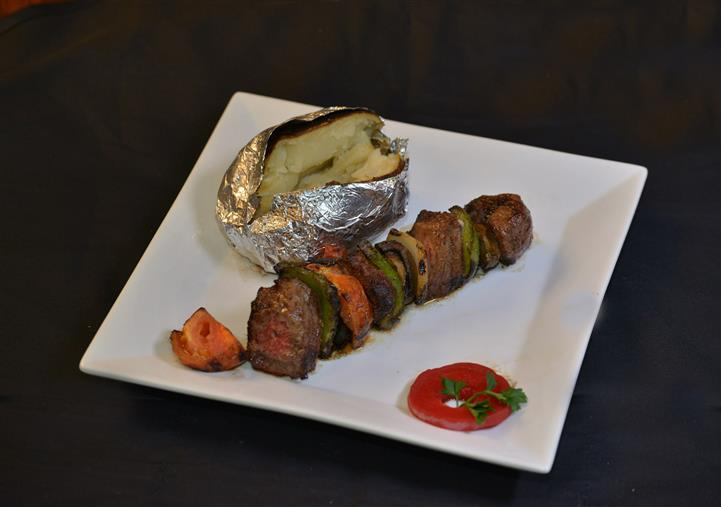 kabobs with a baked potato
