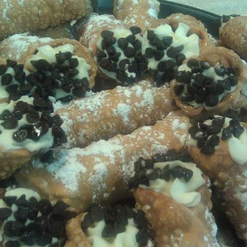 plate of cannolis with chocolate sprinkles
