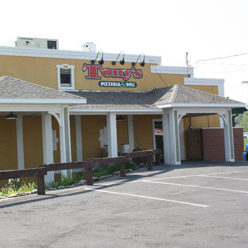 exterior of the building with tony's pizzeria and deli logo on the side