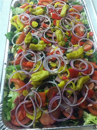 large catering salad tray with peppers, tomatoes, onions and olives