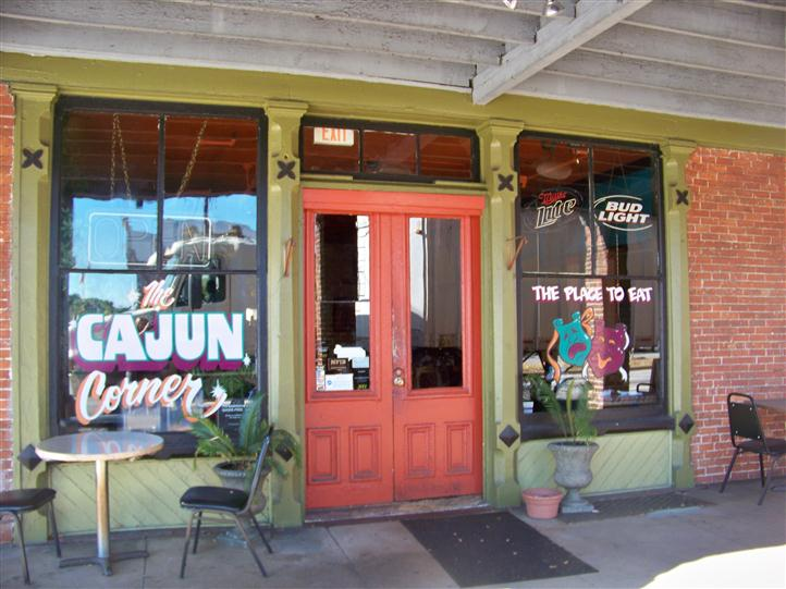exterior entrance to the cajun corner with chairs and tables setup outside