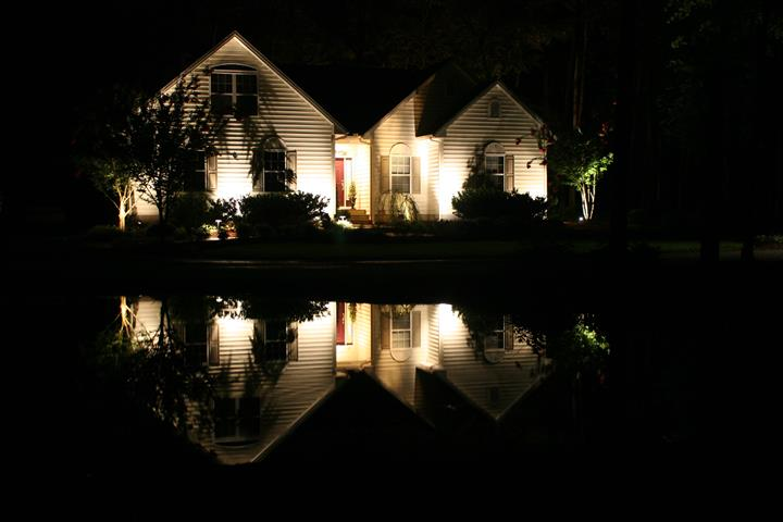 house lit up with outdoor lighting
