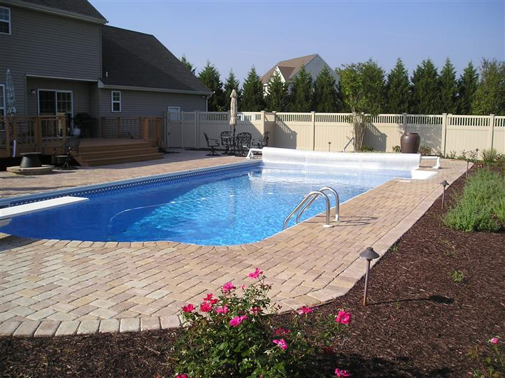 custom pool design with brick work around pool deck