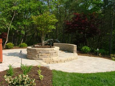 stone platform in back yard with plants and flowers