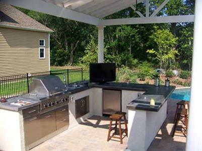 outdoor area with roofing structure and outdoor kitchen