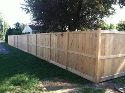 Stick built custom cedar fence