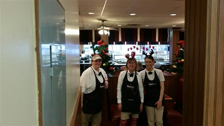 Three staff members wearing uniforms