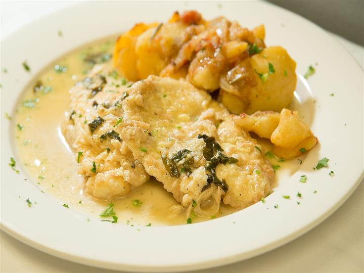 Chicken with a side of potatoes on a plate