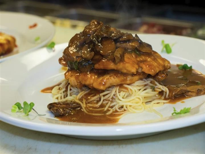 Chicken topped on noodles