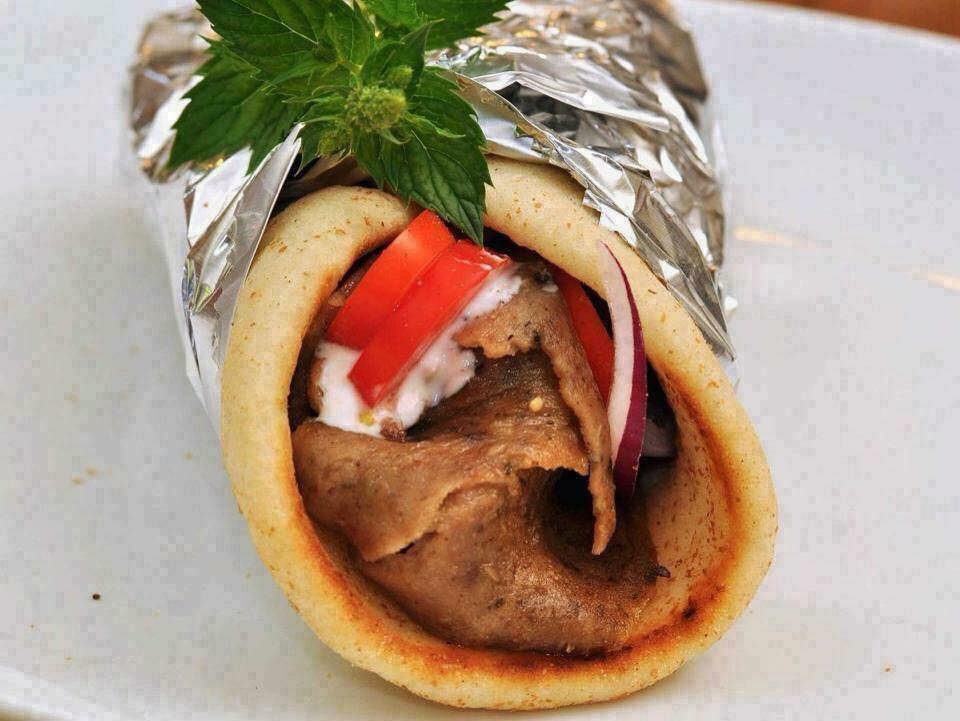 gyro - lamb, tomatoes, onions, tzatziki in pita rolled in foil