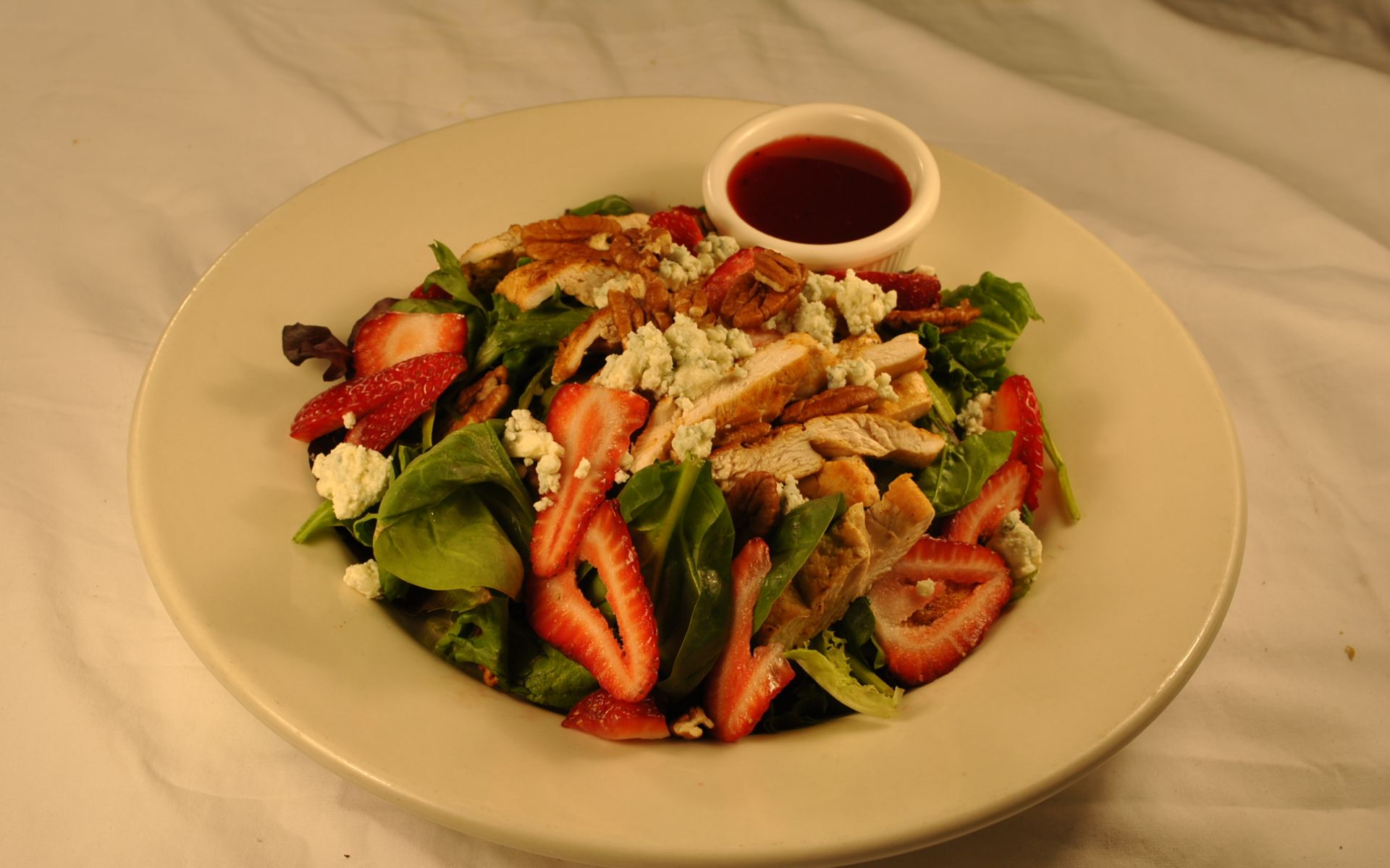 Strawberry chicken mixed green salad with bleu cheese and walnuts