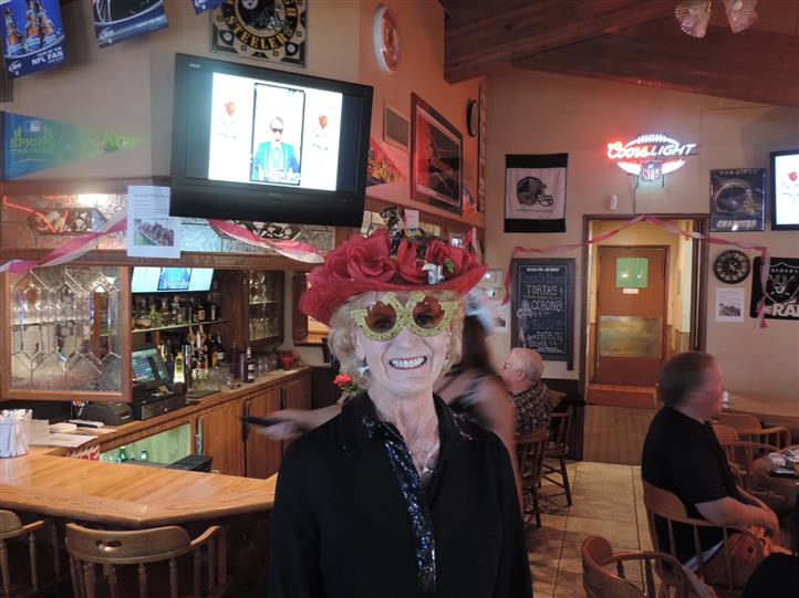 a woman smiling with her kentucky derby fish