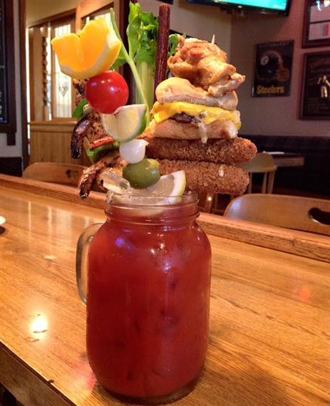 The frankenmary bloody mary drink a 32oz. Bloodymary, a slider, 2 chicken wings, 2 cheese sticks, a grilled shrimp skewer, slim jim, celery, asparagus, and bacon.