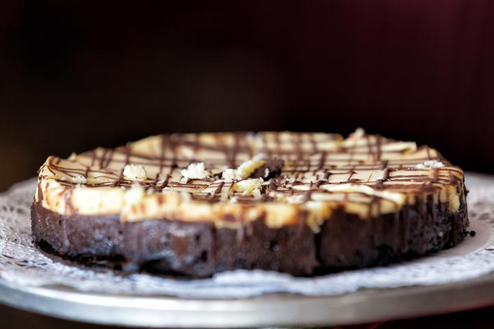 Closeup of cheesecake drizzled with chocolate and caramel