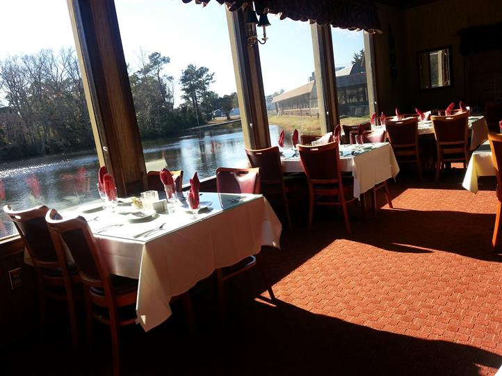 Picture of empty tables with a view of lake at chestnut dining