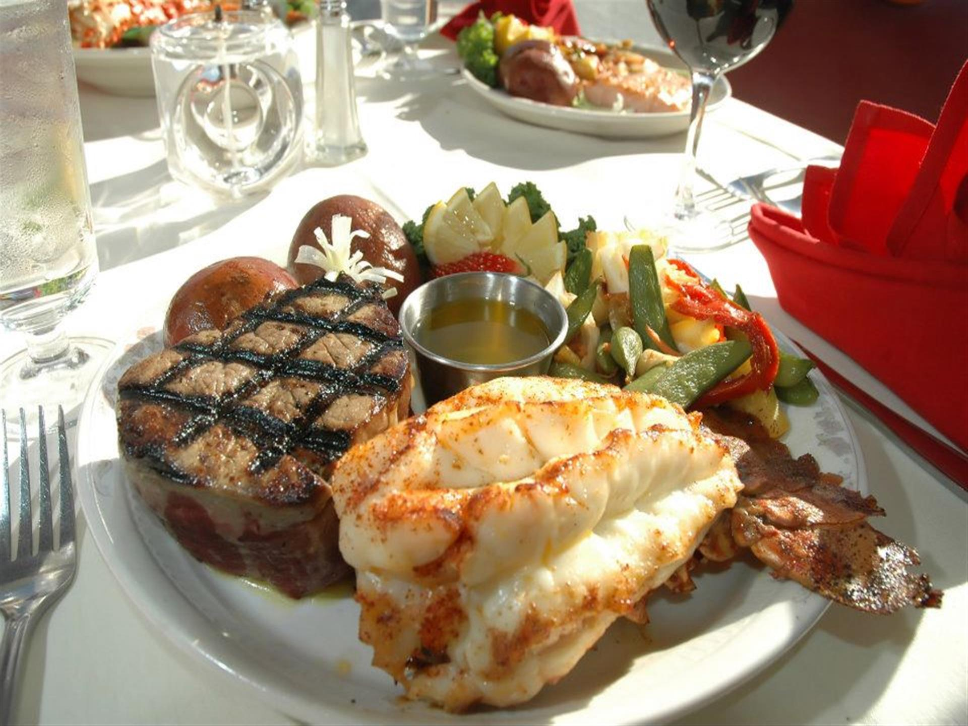 surf and turf plate with steak, lobster tail and vegetables