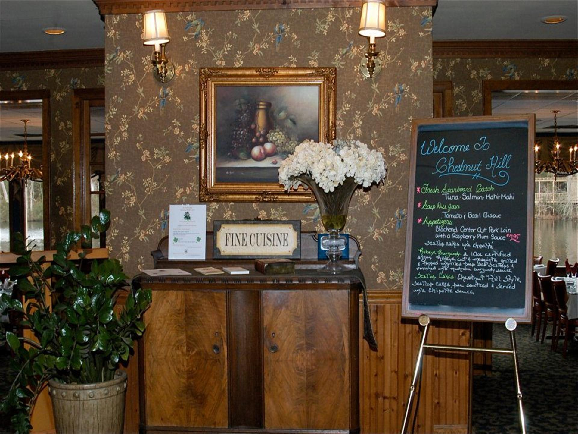 front interior of the chestnut hill with a blackboard of daily specials