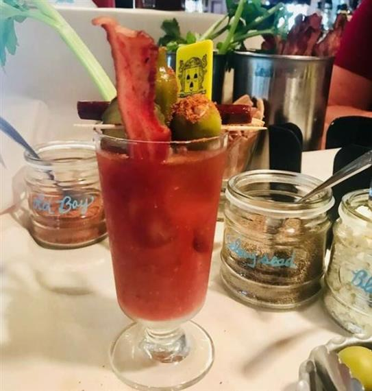 bloody mary with bacon and olives