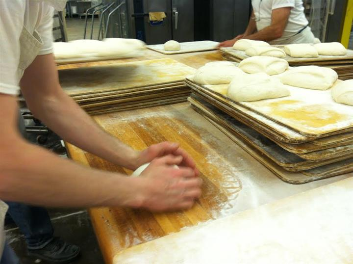 Bakers working dough