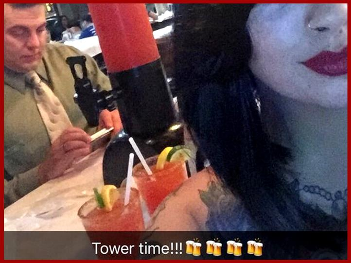 woman taking a selfie in front of a large tower of a frozen drink