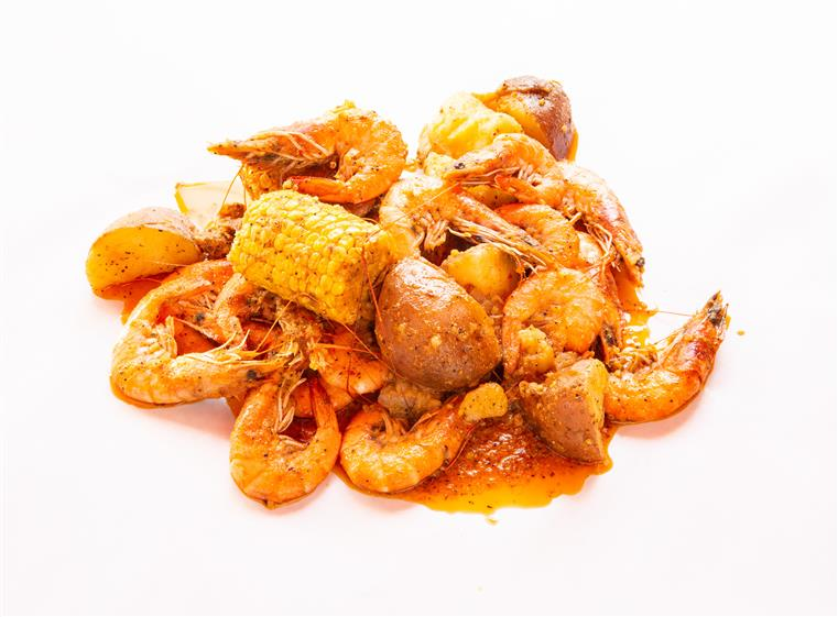 Jumbo Shrimp Louisiana-style with corn and potatoes