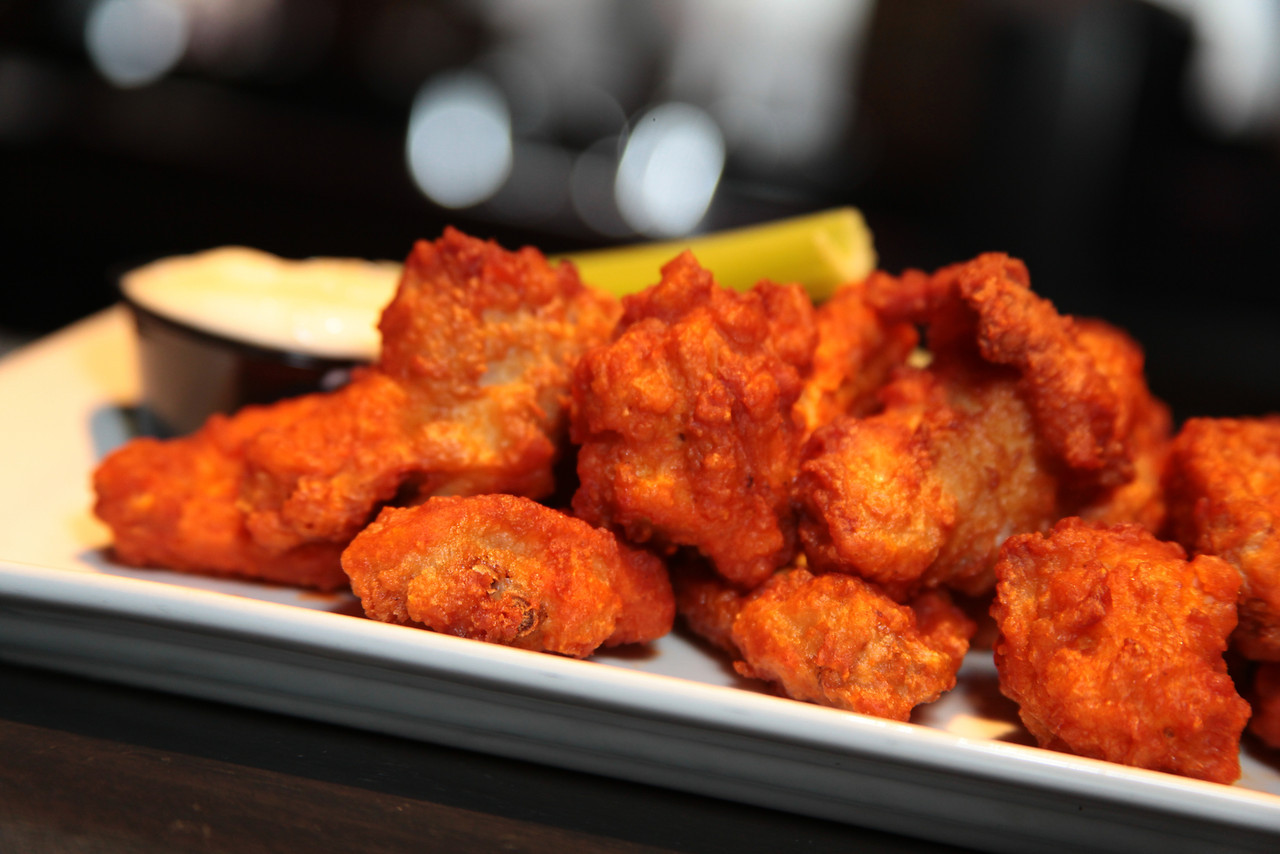 Close-up of buffalo chicken wings with bleu cheese and celery