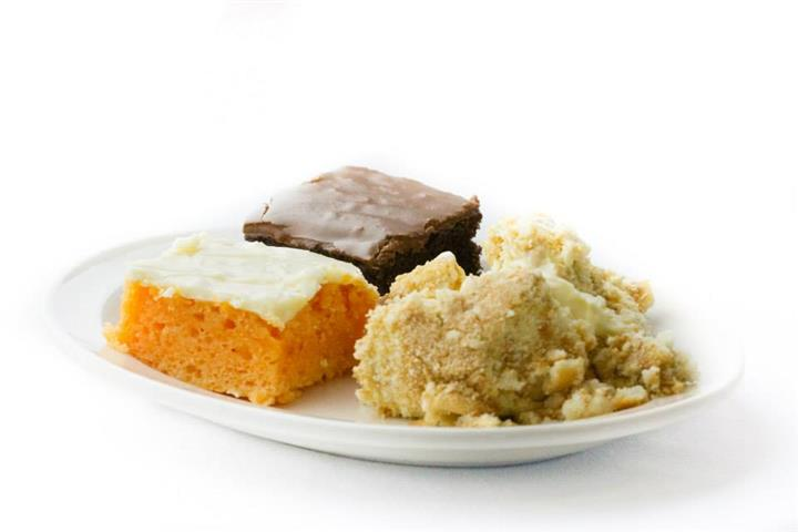 two slices of cake and cobbler